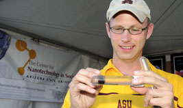 An instructor plays with a tube of ferro-fluid